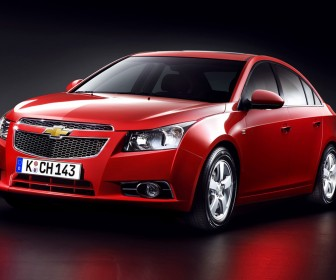 Malibu Red Sedan Front Side View Wallpaper[0]